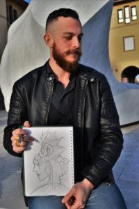 Giuseppe Tuveri con il disegno fatto durante l'intervista.